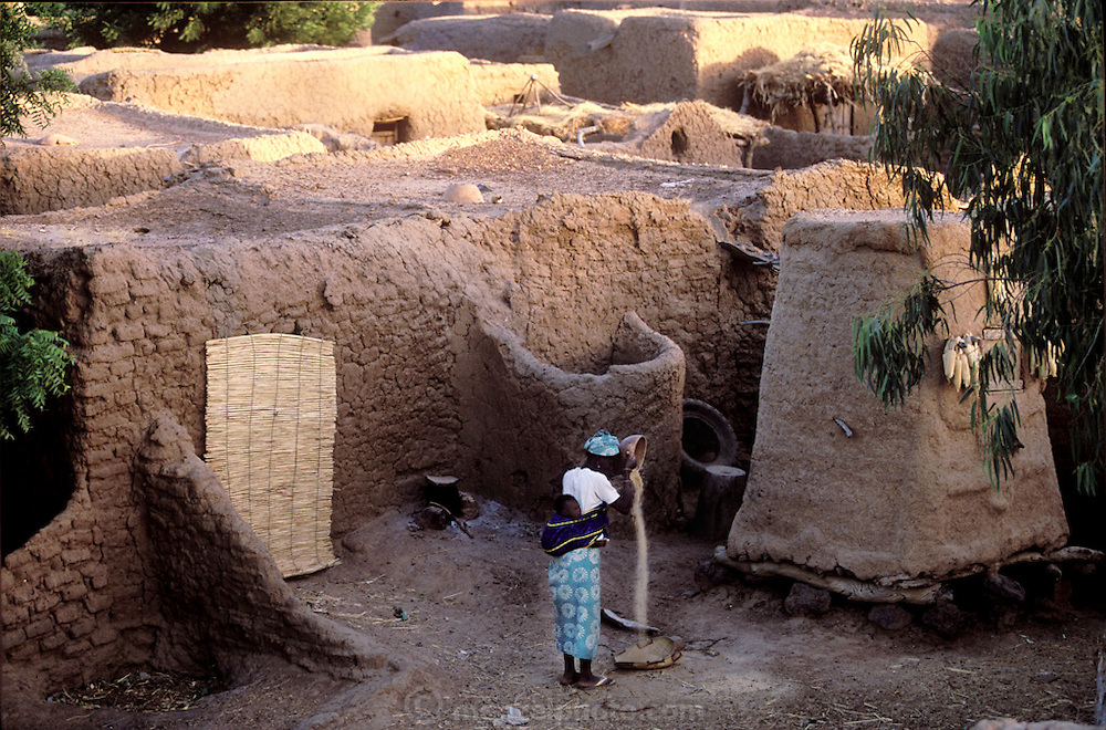 Woman winnowing grain in a village outside of Mopti, Mali near the Niger River. (Supporting image from the project Hungry Planet: What the World Eats.)