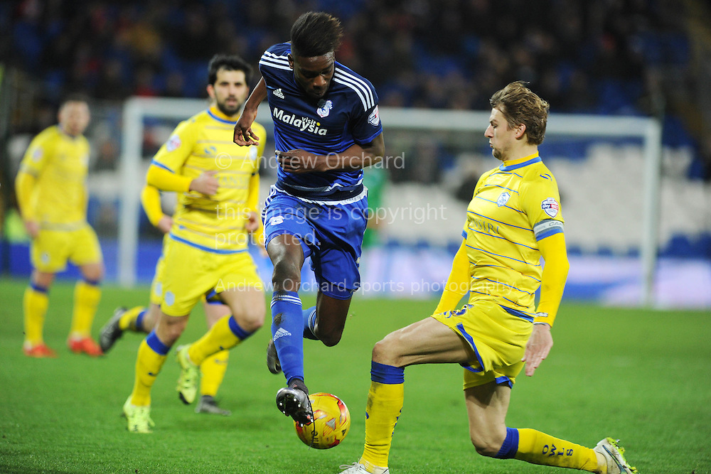 Samuel Ameobi of Cardiff city goes past Glen Loovens of Sheffield Wed (r). Skybet football league championship match, Cardiff city v Sheffield Wednesday at the Cardiff city stadium in Cardiff, South Wales on Saturday 12th December 2015.<br /> pic by Andrew Orchard, Andrew Orchard sports photography.