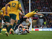 Australia's Scott Fardy trying a fancy offload during the Rugby World Cup Quarter Final match between Australia and Scotland at Twickenham, Richmond, United Kingdom on 18 October 2015. Photo by Matthew Redman.