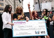 (L-R) Constantine Maroulis, Sebastian Bach, winner Debra Diamant and David Z pose after winning the Season 2 IFC 'Hottest Rocker Mom Contest' finale presentation on the Madison Square Park Traffic Island in New York City, USA on June 3, 2009.