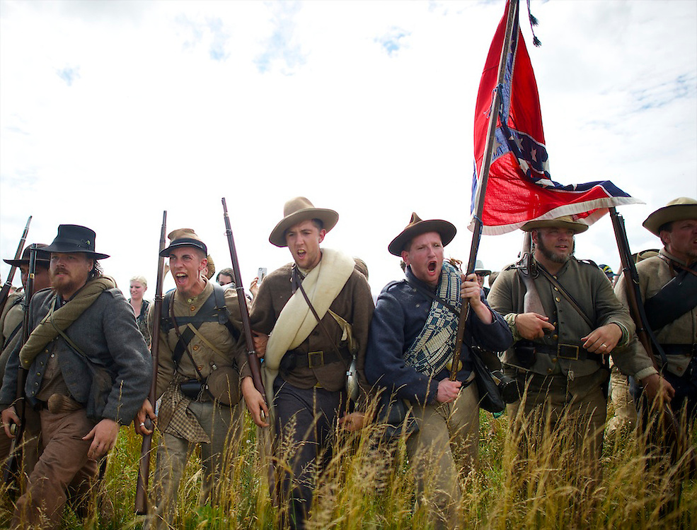 Confederate soldiers (L-R) Geoff Roecker, David Pollinger, James Bevan, Jim Taub, and Chuck Gerhardt scream the rebel yell as an estimated 10,000 people recreated Pickett's Charge at the exact moment it occurred 150 years ago (July 3, 1853) during sesquicentennial Battle of Gettysburg events n Gettysburg, PA on July 3, 2013.