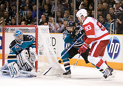 April 29, 2010; San Jose, CA, USA; San Jose Sharks defenseman Dan Boyle (center) fights for the puck with Detroit Red Wings right wing Johan Franzen (93) in front of Sharks goaltender Evgeni Nabokov (20) during the third period in game one of the western conference semifinals of the 2010 Stanley Cup Playoffs at HP Pavilion. The Sharks defeated the Red Wings 4-3. Mandatory Credit: Jason O. Watson / US PRESSWIRE