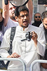 © Licensed to London News Pictures . London , UK . Siddhartha Dhar (C holding a camera) at a burning of an American flag a Muslims Against Crusades demonstration outside the American Embassy in Grosvenor Square on the tenth anniversary of the 9/11 attacks in London on September 11, 2011. There has been speculation that Siddhartha Dhar is this the new 'Jihadi John', who appeared in a recent ISIS video . Photo credit : Joel Goodman/LNP