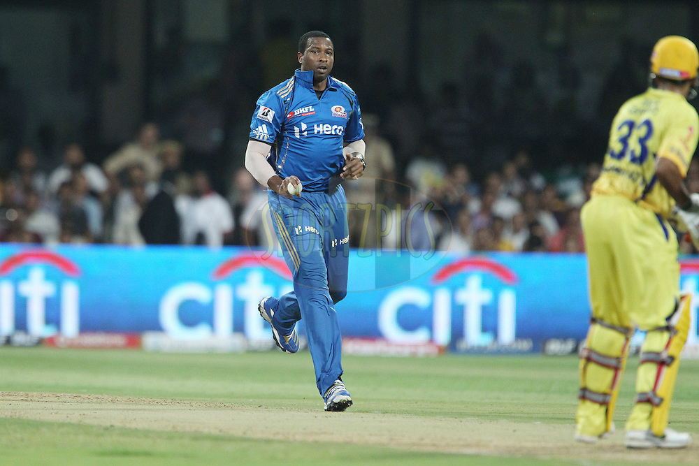 Kieron Pollard bowls but doesn't release the ball during The IPL 2012, Season 5, eliminator match between The Mumbai Indians and The Chennai Superkings held at the M. Chinnaswamy Stadium, Bengaluru on the 23rd May 2012..Photo by Ron Gaunt/IPL/SPORTZPICS