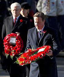 © London News Pictures. 11/11/2012. London, UK. British Prime Minister David Cameron laying a wreath during a Remembrance Day Ceremony at the Cenotaph on November 11, 2012 in London, United Kingdom. Photo credit: Ben Cawthra/LNP
