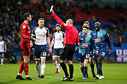 Referee Graham Salisbury gives a yellow card to Bolton Wanderers goalkeeper Remi Matthews during the EFL Sky Bet League 1 match between Bolton Wanderers and Wycombe Wanderers at the University of  Bolton Stadium, Bolton, England on 15 February 2020.