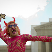 A man dressed as the Devil mocked those opposed to gay marriage outside the Supreme Court during the hearings on California's Proposition 8, which recognized marriage only between a man and woman.  March 26, 2013. John Boal Photography.