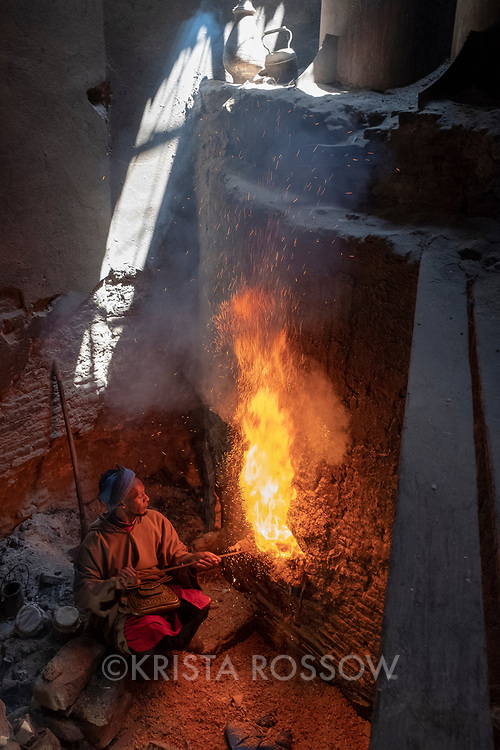 A man stokes the fire at a hammam inside of the Medina of Marrakech, Morocco.