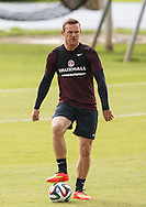 Wayne Rooney of England looks on during the England training session at Est&aacute;dio Claudio Coutinho, Rio de Janeiro, Brazil<br /> Picture by Andrew Tobin/Focus Images Ltd +44 7710 761829<br /> 21/06/2014