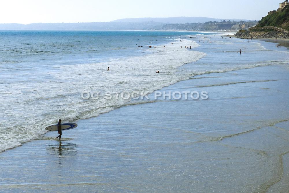 Longboard Surfer at Low Tide in San Clemente