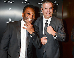 Pele arrived at the Hublot store in New Bond Street prior to accepting the<br /> HMV Football Extravaganza Lifetime achievement award. In celebration of<br /> Pele's birthday Ricardo Guadalupe , CEO, Hublot presented the ledgendary<br /> footballer with a pair of Hublot All black carbon cuff links - 29th October 2013.<br /> Picture shows:-Pele and Ricardo Guadalupe , CEO, Hublot.