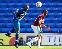 Photo: Daniel Hambury.<br /> Reading v Burnley. Coca Cola Championship.<br /> 29/08/2005.<br /> Reading's Ibrahima Sonko beats and Burnley's Gifton Noel-Williams to the ball.