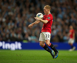 MANCHESTER, ENGLAND - Monday, April 30, 2012: Manchester United's Paul Scholes in action against Manchester City during the Premiership match at the City of Manchester Stadium. (Pic by David Rawcliffe/Propaganda)