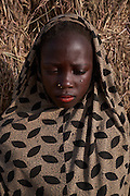 A girl stands outside a shelter in a camp of internally displaced people by the side of the road on the highway outside of Diffa, Niger on February 14, 2016. Caritas undertook a distribution of two blankets per family in January, 2016. Most of the displaced people are from the town of Chilori, Niger on the border with Nigeria and fled when the village was attacked by Boko Haram.