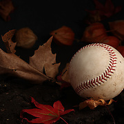 An authentic Rawlings used baseball from the 2012 Major League Baseball season showing the red stitching and markings in an Autumn scene. 16th May 2012. Photo Tim Clayton