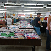 HIALEAH, FLORIDA - JUNE 24, 2016<br /> Shoppers browse items for sale in Noooo (&ntilde;oooo) Que Barato,  in Hialeah, Florida. The store sells all kinds of goods and is a very popular stop for Cubans who are traveling to Cuba to stock up on supplies to carry to relatives in the island nation.<br /> (Photo by Angel Valentin/Freelance)