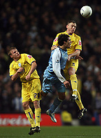 Photo: Paul Thomas.<br /> Manchester City v Sheffield Wednesday. The FA Cup. 16/01/2007.<br /> <br /> Bernardo Corradi (Blue) of Man City gets in between Frank Simek (L) and Graham Coughlin.