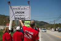 Todd Ross holds his sign up high as motorists pass by and honk to show their support along the Tenney Mountain Highway outside of the New Hampshire Electric Coop headquarters Friday morning.  (Karen Bobotas/for the Laconia Daily Sun)