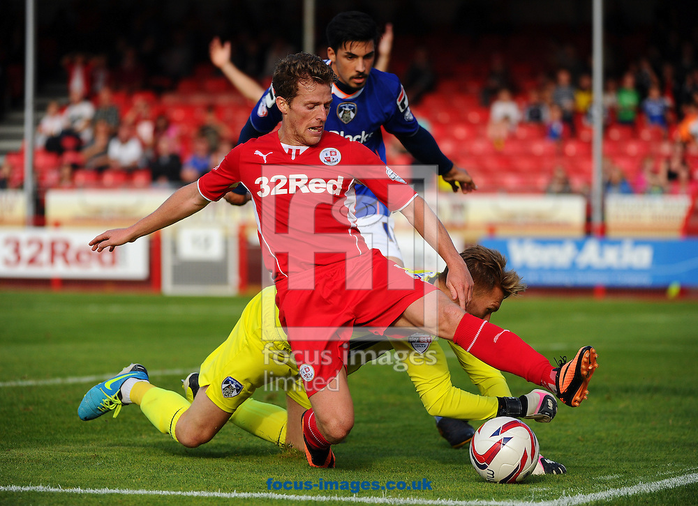 Picture by Seb Daly/Focus Images Ltd +447738 614630<br /> 28/09/2013<br /> Billy Clarke of Crawley Town and Mark Oxley of Oldham Athletic during the Sky Bet League 1 match at Broadfield Stadium, Crawley.