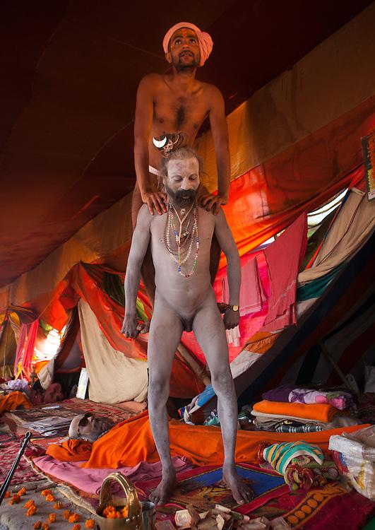 Naga Sadhu doing performance with his penis, Maha Kumbh Mela festival, world's largest congregation of religious pilgrims. Allahabad, India.