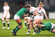 England player Hannah Botterman takes on 2 Irish tacklers in the first half during the Women's 6 Nations match between Ireland Women and England Women at Energia Park, Dublin, Ireland on 1 February 2019.