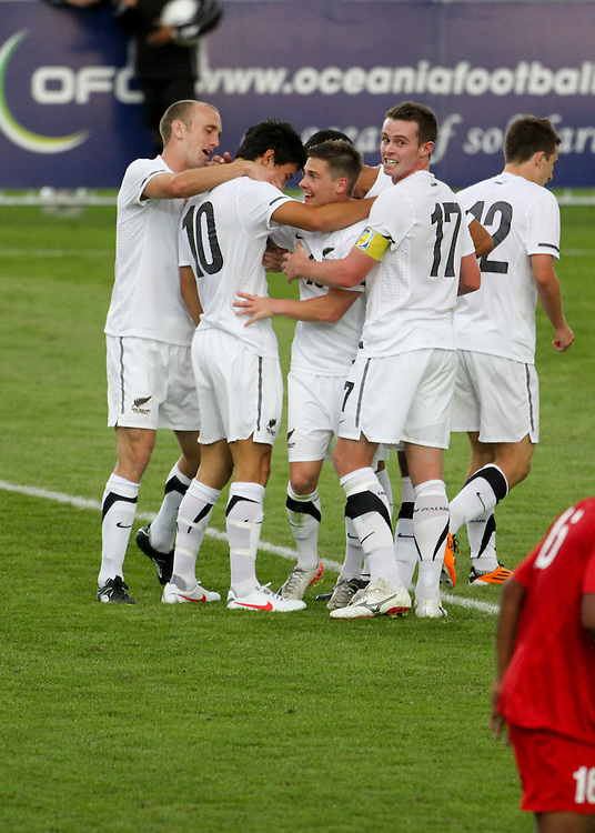 New Zealand's Sean lovemore, second from left, is congratulated by team mates after scoring against Papua New Guinea in the teams OFC Mens Olympic qualifier football match, Owen Delany Park, Taupo, New Zealand, Friday, March 16, 2012. Credit:SNPA / John Cowpland
