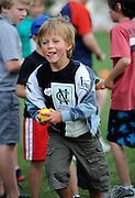 Cricket fan Carter Smith looks to bowl the ball at the National Bank's Cricket Super Camp , University oval, Dunedin, New Zealand. Thursday 2 February 2012 . Photo: Richard Hood photosport.co.nz