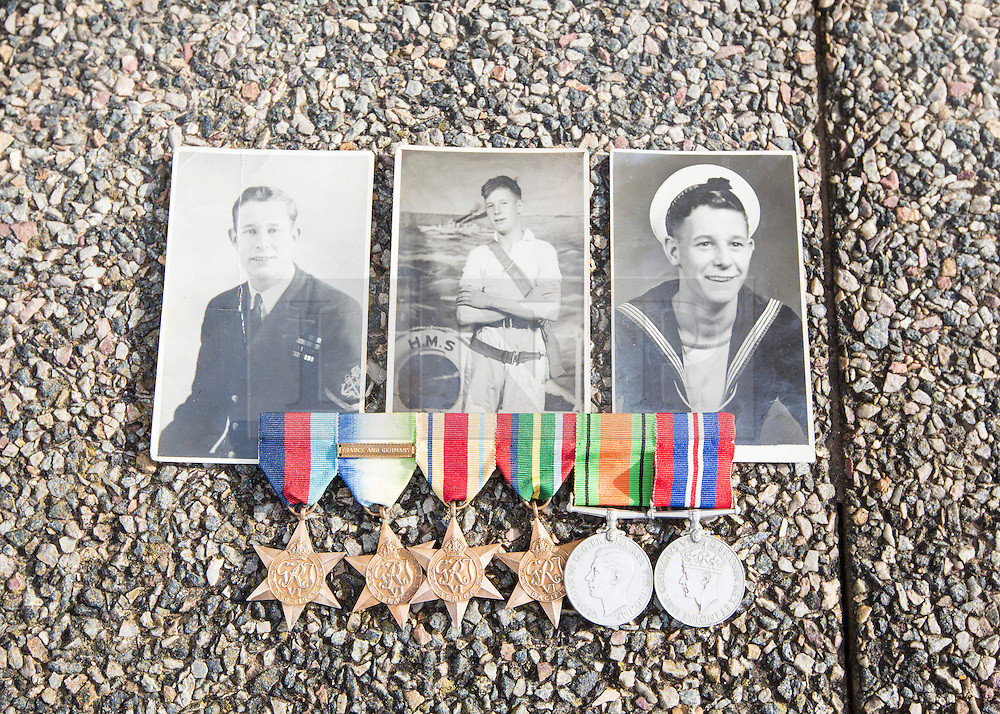 Medals and photographs of the husband of Mary Eales, 80 who brought them to Normandy to see where he served.  Lesley Eales served with the Royal Navy and although he survived the Second World War he passed away, leaving Mary with his medals. Photo credit : Alison Baskerville/LNP