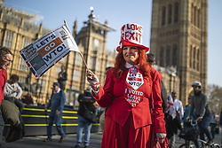 March 29, 2019 - London, UK - Brexit supporter in fancy dress waves a flag outside Parliament during a Leave Means Leave rally. MPs have voted to reject Prime Minister Theresa MayÃ•s withdrawal agreement for a third time today. (Credit Image: © Rob Pinney/London News Pictures via ZUMA Wire)