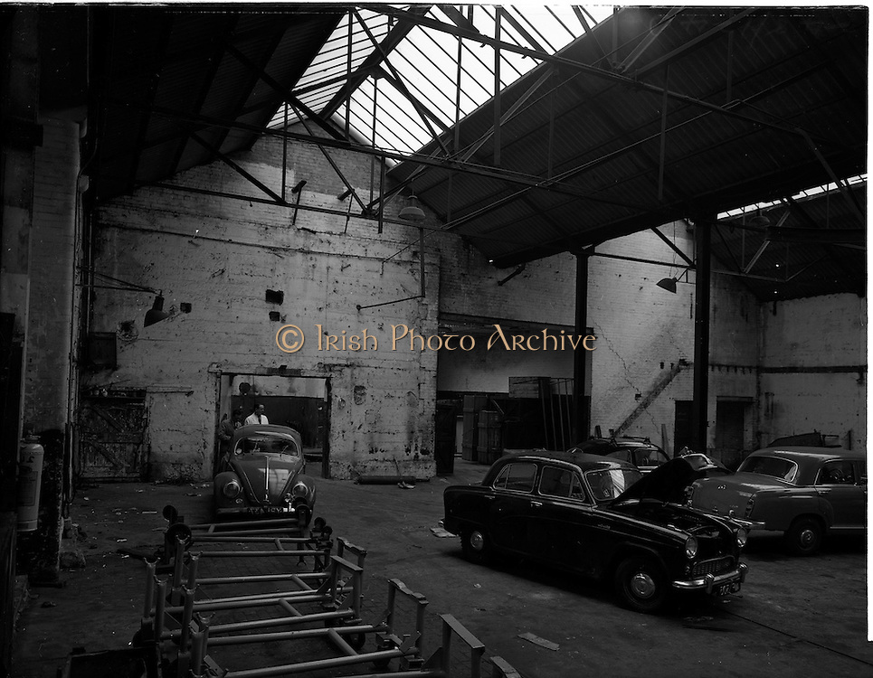 08/12/1959<br /> 12/08/1959<br /> 08 December 1959<br /> Pictures of the interior of Ballsbridge Motors, Shelbourne Road,  Dublin, before renovation. The premises had been a tram depot until the 1940's.