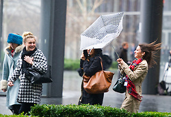 Office workers scamper for cover as torrential rain and  strong winds hit London, Wednesday, 12th February 2014. Picture by i-Images