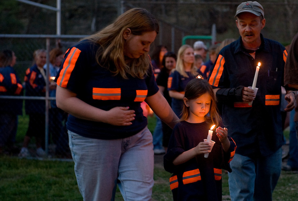 Melissa Roop, left, Annika Roop, 5, center, and Terry Roop, all of Sylvester, WV, attend a candlelight vigil in Whitesville, WV on Wednesday, April 7, 2010.  Communities across Boone and Raleigh counties held vigils and services for the fallen miners and their families.