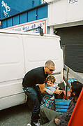 Man holding son outside Chariot Spa, Chariot Spa, Fairchild St, Shoreditch, London May 2016