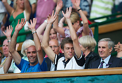 LONDON, ENGLAND - Saturday, June 26, 2010: Marathon man Nicolas Mahut (FRA) joins in the Mexican Wave, but Wimbledon's Committee Chairman Tim Phillips doesn't, during the Gentlemen's Singles 3rd Round on day six of the Wimbledon Lawn Tennis Championships at the All England Lawn Tennis and Croquet Club. (Pic by David Rawcliffe/Propaganda)