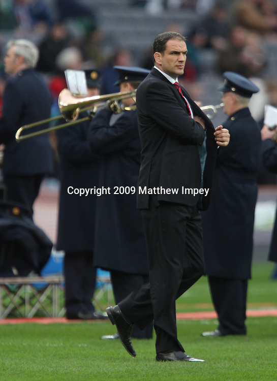 Martin Johnson the England team manager walks past the Dublin Garda band before the match. Ireland v England, 6 Nations Rugby Championship, Rugby Union, Croke Park, Dublin, 28/02/2009 © Matthew Impey/Wiredphotos.co.uk. tel: 07789 130 347 email: matt@wiredphotos.co.uk