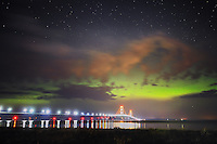 The Northern Lights illuminate the sky over the Mackinac Bridge during the early hours of July 15, 2013<br /> <br /> Mackinaw City, Michigan