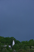 Sudden storm approaching famous lighthouse.