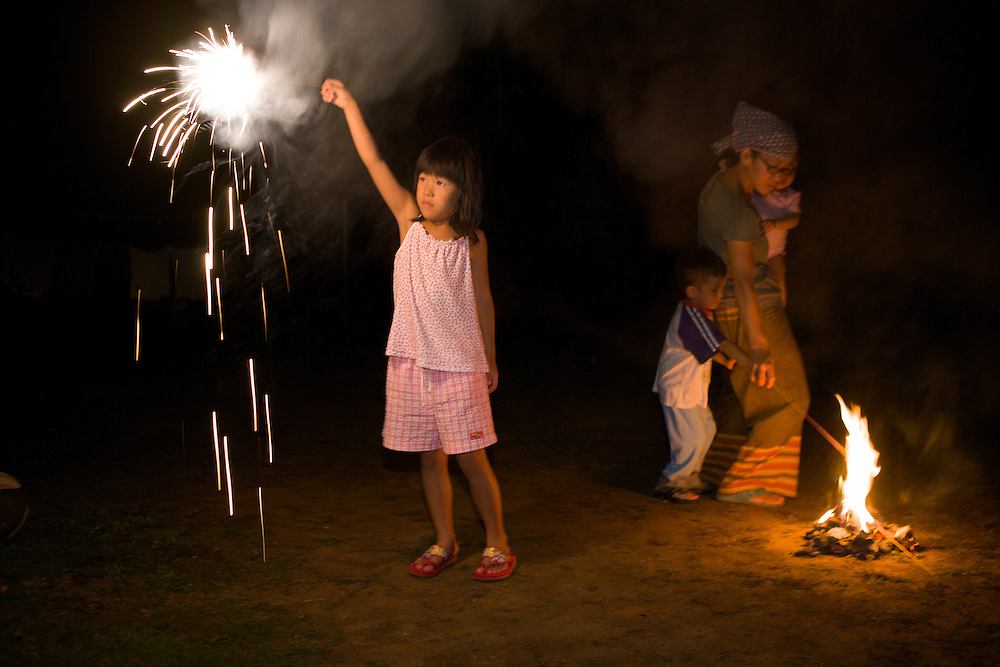 Sayoko and her ffiend's kids play with firecracker in the evening