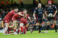 Rugby Union - 2016 / 2017 Pro12 - [Judgement Day V]: Newport Gwent Dragons vs. Scarlets<br /> <br /> Gareth Davies  of Llanelli Scarlets  passes the ball out, at Principality Stadium [Millennium Stadium], Cardiff.<br /> <br /> COLORSPORT/WINSTON BYNORTH