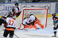 KELOWNA, CANADA, OCTOBER 11: Tyler Bunz #30 of the Medicine Hat Tigers makes a save as the Medicine Hat Tigers visited the Kelowna Rockets on October 11, 2011 at Prospera Place in Kelowna, British Columbia, Canada (Photo by Marissa Baecker/shootthebreeze.ca) *** Local Caption ***Tyler Bunz;