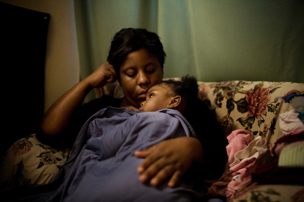 "Lettorea ""Lottie"" Clark, 25, snuggles with her daughter Gabby, 2 in their apartment in Albany, GA on Friday, October 24, 2008 as Lottie prepares Gabby for a nap. Clark is bipolar and lives off welfare."