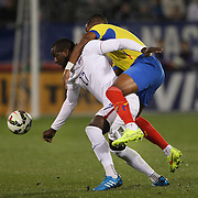 Jozy Altidore, (left), USA, is challenged by Frickson Erazo, Ecuador, during the USA Vs Ecuador International match at Rentschler Field, Hartford, Connecticut. USA. 10th October 2014. Photo Tim Clayton