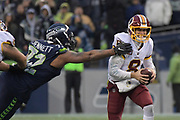 Nov 5, 2017; Seattle, WA, USA; Washington Redskins quarterback Kirk Cousins (8) is pressured by Seattle Seahawks defensive end Michael Bennett (72) during an NFL football game at CenturyLink Field. The Redskins defeated the Seahawks 17-14.