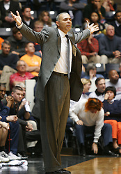 UVA head coach Dave Leitao disputes a referee's call that went against Virginia.  Leitao improved to 3-1 overall in his first season at UVA with a 72-57 victory over Northwestern...The Virginia Cavaliers Men's Basketball team defeated the Northwestern Wildcats 72-57 in the ACC/BigTen Challenge at University Hall in Charlottesville, VA on November 30, 2005..