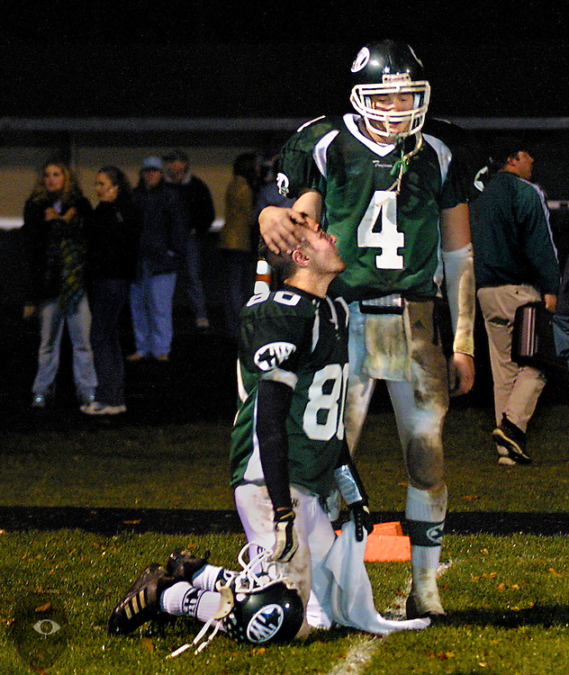 Wilson players Gates Anderton (80) and QB Sean Setzer (4) console one another in the end zone following their loss to Pendleton 21-27 in overtime, thus knocking them out of the Class 4A playoffs.