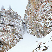 Forrest Jillson hiking up a mini-golf couloir in the Tetons.