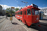 Kauppatori (Market Square). Sparakoff, the fiery red Pub Tram operated by Koff beer brewery.