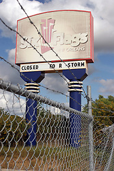 24th November 2010. New Orleans, Louisiana, USA. <br /> 'Closed for storm.' Not amusing any more. Six Flags amusement park radiates an eerie post apocalyptic sense of foreboding in it's abandonment. The park was destroyed by hurricane Katrina , stripped by copper thieves and is slowly being reclaimed by the land it stands on. It is slated for demolition following a lease dispute between the City and Six Flags.<br /> Photo; Charlie Varley/varleypix.com