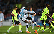 Huddersfield Town striker Ishmael Miller shoots during the Sky Bet Championship match between Huddersfield Town and Brighton and Hove Albion at the John Smiths Stadium, Huddersfield, England on 18 August 2015.