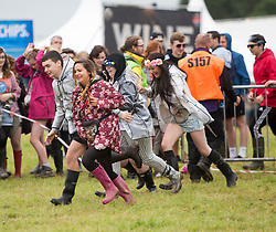 People rushing into the main site. Friday, 10th July 2015, First day at T in the Park 2015, at its new home at Strathallan Castle.